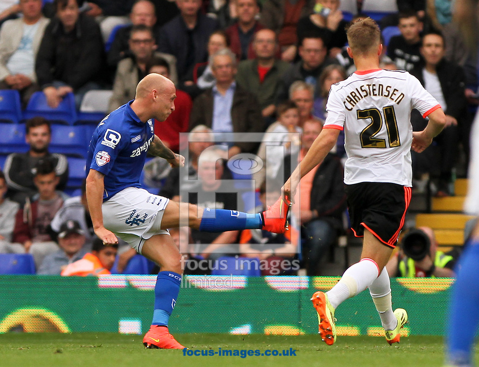 David Cotterill (left) of Birmingham City scores his sides first goal during the Sky Bet Championship match at St Andrews, Birmingham<br /> Picture by Tom Smith/Focus Images Ltd 07545141164<br /> 27/09/2014