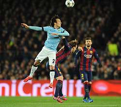 Manchester City's David Silva challenges for the header with Barcelona's Ivan Rakitic - Photo mandatory by-line: Dougie Allward/JMP - Mobile: 07966 386802 - 18/03/2015 - SPORT - Football - Barcelona - Nou Camp - Barcelona v Manchester City - UEFA Champions League - Round 16 - Second Leg
