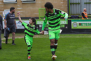 Mascot with Forest Green Rovers Reuben Reid(26) during the EFL Sky Bet League 2 match between Forest Green Rovers and Chesterfield at the New Lawn, Forest Green, United Kingdom on 21 April 2018. Picture by Shane Healey.