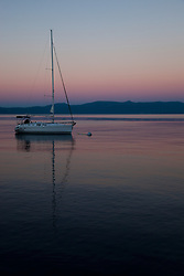 """Sailboat and Sunset on Lake Tahoe 2"" - This serene sunset was photographed from the West shore of Lake Tahoe, California."