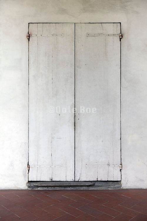 door painted in the color of the wall