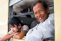 YANGON, MYANMAR - CIRCA DECEMBER 2013: Happy passenger smiles in the Yangon Central Railway Station