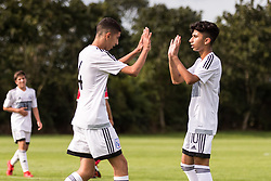 WREXHAM, WALES - Thursday, August 15, 2019: Cyprus' Konstantinos Yiannacou celebrates scoring the fifth goal with Konstantinos Evripidou during the UEFA Under-15's Development Tournament match between Cyprus and Malta at Colliers Park. (Pic by Paul Greenwood/Propaganda)