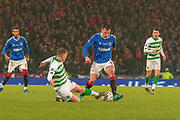 Callum McGregor of Celtic FC goes to ground and dispossess Ryan Jack of Rangers FC during the Betfred Scottish League Cup Final match between Rangers and Celtic at Hampden Park, Glasgow, United Kingdom on 8 December 2019.