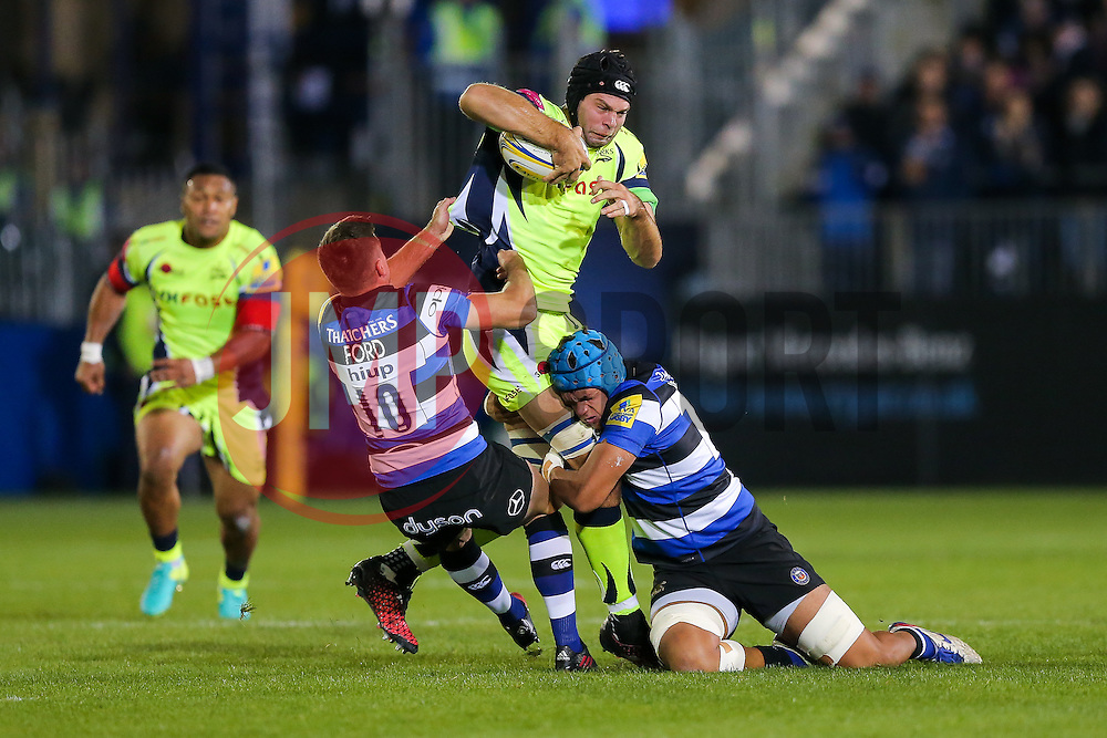 Josh Beaumont (capt) of Sale Sharks is tackled by George Ford (capt) and Zach Mercer of Bath Rugby - Rogan Thomson/JMP - 07/10/2016 - RUGBY UNION - The Recreation Ground - Bath, England - Bath Rugby v Sale Sharks - Aviva Premiership.