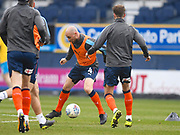 Luton Town player Alan McCormack warms up before the game during the EFL Sky Bet League 2 match between Luton Town and Barnet at Kenilworth Road, Luton, England on 24 March 2018. Picture by Ian  Muir.