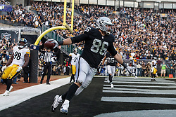OAKLAND, CA - DECEMBER 09: Tight end Lee Smith #86 of the Oakland Raiders celebrates after scoring a touchdown against the Pittsburgh Steelers during the fourth quarter at O.co Coliseum on December 9, 2018 in Oakland, California. The Oakland Raiders defeated the Pittsburgh Steelers 24-21. (Photo by Jason O. Watson/Getty Images) *** Local Caption *** Lee Smith