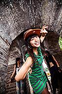Lao Thi Sao Mai posing with her hip-hop dancing crew, Cun Cun,Hoan Kiem Lake, Vietnam, Southeast Asia