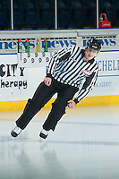 KELOWNA, CANADA - JANUARY 7: Linesman Ward Pateman enters the ice as the Kelowna Rockets host the Vancouver Giants on January 7, 2015 at Prospera Place in Kelowna, British Columbia, Canada.  (Photo by Marissa Baecker/Shoot the Breeze)  *** Local Caption *** Ward Pateman;