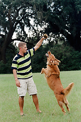 man playing with his dog on a lawn in South Carolina