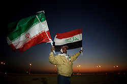A local man from Doha sells Iraq and Iran flags in the desert before the Group D match Iraq v Iran in the 2011 Asian Cup in Qatar