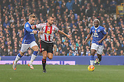 Sunderland midfielder Lee Cattermole holds off Everton forward Gerard Deulofeu during the Barclays Premier League match between Everton and Sunderland at Goodison Park, Liverpool, England on 1 November 2015. Photo by Simon Davies.