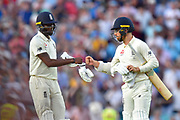 Jofra Archer of England and Jack Leach of England touch gloves at the end of play on day 3 during the 5th International Test Match 2019 match between England and Australia at the Oval, London, United Kingdom on 14 September 2019.