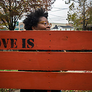 WASHINGTON, DC - NOV 16 :  Kimberly Gaines, a community organizer, carries a pallet November 16, 2013, to a community harvest festival (which was postponed due to weather) at the Riverside center in Deanwood, Washington, DC. The pallets will be put up around the park for people to write their feelings on. Gaines and fellow community organizer Sheshat Walker are working on a project called My Deanwood, where they photograph community members and write stories about them. (Photo by Evelyn Hockstein/For The Washington Post)