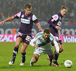 23.10.2011, Generali Arena, Wien, AUT, 1. FBL, Wiener Derby FK Austria Wien vs SK Rapid Wien, im Bild vl Alexander Gruenwald, (FK Austria Wien, #10), Guido Burgstaller, (SK Rapid Wien, #30) und Florian Klein, (FK Austria Wien, #7) // during the vienna derby FK Austria Wien vs SK Rapid Wien, Generali Arena, Vienna, 2011-10-23, EXPA Pictures © 2011, PhotoCredit: EXPA/ M. Gruber