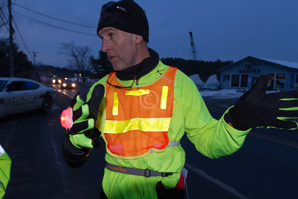 Gary Allen runs from Maine to Washington DC,determining route after putting on Glimmer Gear as dusk approaches along Bath Road near Brunswick