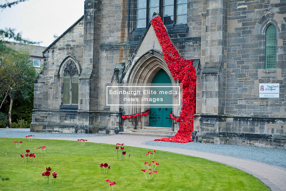 Ahead of Remembrance Day a display of knitted poppies, made by members of the church and the community, cascade down the side of the main entrance to Portobello and Joppa Parish church in Portobello Edinburgh. © Jon Davey/ EEm