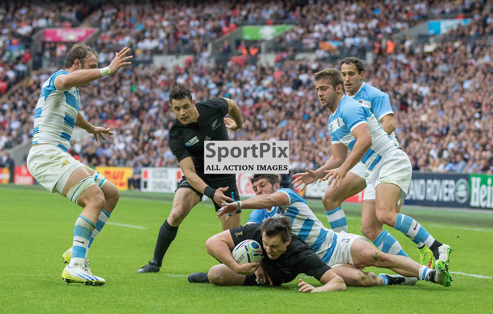 Ben Smith is tackled during the Rugby World Cup New Zealand v Argentina, Sunday 20 September 2015, Wembley Stadium (Photo by Mike Poole)