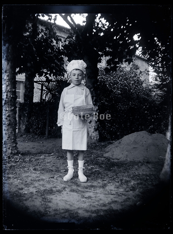 young boy in cooking uniform France 1923