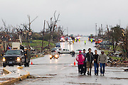 May 23, 2011- Survivors walk on East 20th Street in Joplin, Missouri after a Tornado came through the town on Sunday, May 22, 2011. Credit: David Welker / TurfImages.com