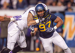 Oct 22, 2016; Morgantown, WV, USA; West Virginia Mountaineers defensive lineman Noble Nwachukwu (97) pressures the quarterback during the fourth quarter against the TCU Horned Frogs at Milan Puskar Stadium. Mandatory Credit: Ben Queen-USA TODAY Sports