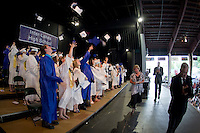 The Inter Lakes High School graduating class celebrates after receiving their diplomas Friday eveing at Meadowbrook Pavilion.  (Karen Bobotas/for the Laconia Daily Sun)