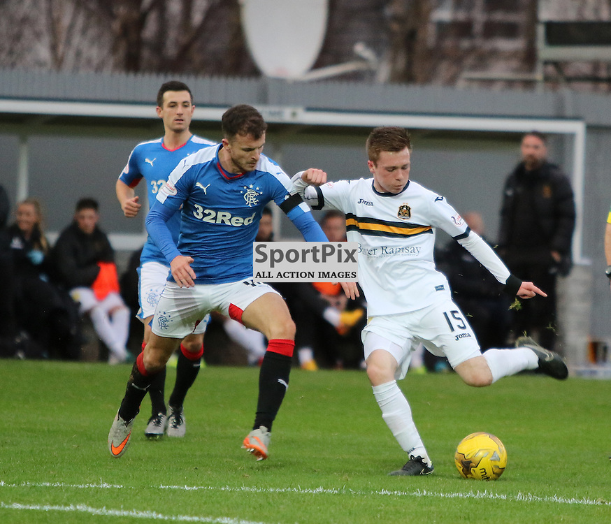 Young Donald McCallum tries a shot during the Dumbarton v Rangers  Scottish Championship  02 January 2016<br /> <br /> (c) Andy Scott | SportPix.org.uk