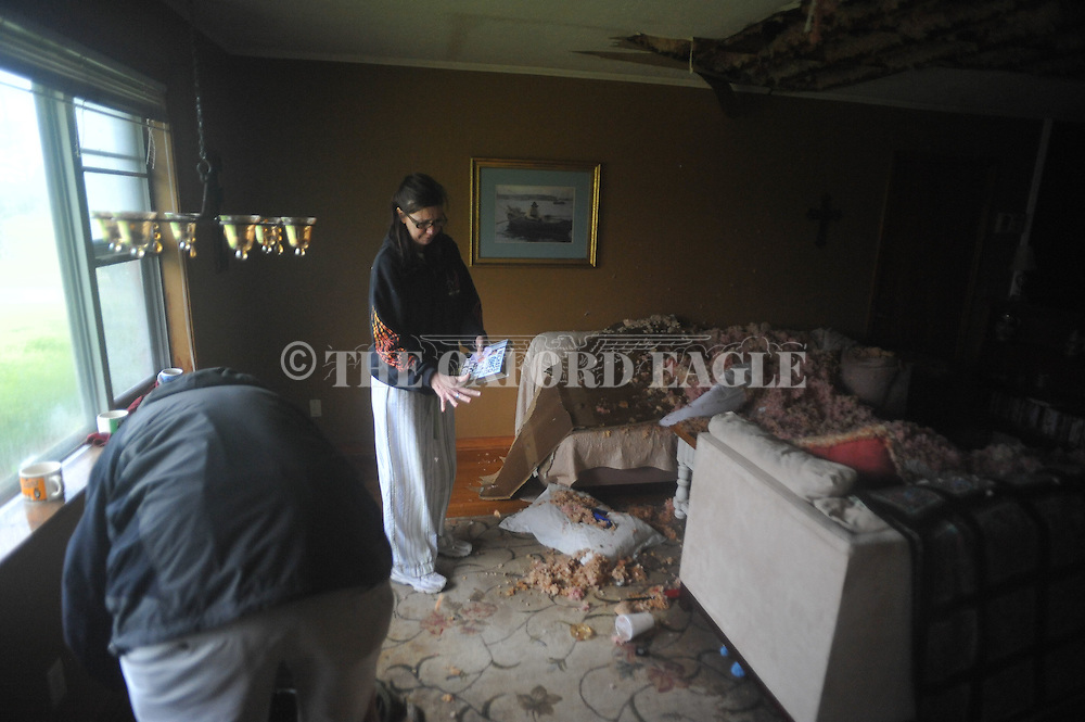 Stephanie Scimo looks over storm related damage to the duplex she rents in Oxford, Miss. on Wednesday, April 27, 2011.
