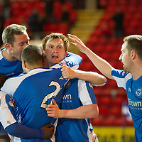 St Johnstone v Dundee United.....01.04.13      SPL<br /> Liam Craig celebrates his late equaliser which guarantee's saints a top six place. Team mate Steven MacLean is pictured right congratulating him after he earlier missed a sitter<br /> Picture by Graeme Hart.<br /> Copyright Perthshire Picture Agency<br /> Tel: 01738 623350  Mobile: 07990 594431