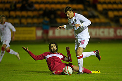 CARMARTHEN, WALES - Wednesday, October 20, 2010: Wales' Billy Bodin is blocked by Turkey's Furkan Seker in the area and a penalty is awarded during the UEFA Under-19 Championship Qualifying Group 1 match at Richmond Park. (Photo by Gareth Davies/Propaganda)