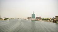 Lagos skyline over creek between Victoria Island and Ikoya.