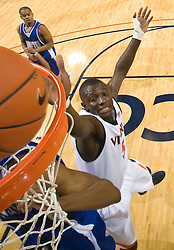 Virginia center Assane Sene (5) tips the ball back in for a basket against Hampton.  The Virginia Cavaliers defeated the Hampton Pirates 74-48 at the John Paul Jones Arena on the Grounds of the University of Virginia in Charlottesville, VA on December 23, 2008. (Special to the Daily Progress / Jason O. Watson)