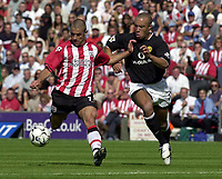 Photo: Greig Cowie.<br /> 31/08/2003.<br /> FA Barclaycard Premiership. Southampton v Manchester United. The Saint Marys Stadium.<br /> Kevin Phillips lines one up as Mikael Silvestre covers