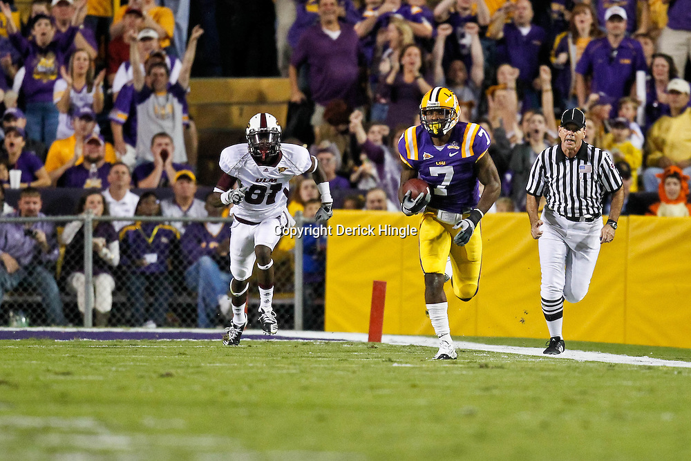 November 13, 2010; Baton Rouge, LA, USA; LSU Tigers cornerback Patrick Peterson (7) returns an interception as Louisiana Monroe Warhawks wide receiver Tavarese Maye (81) pursues the play during the first half at Tiger Stadium.  Mandatory Credit: Derick E. Hingle