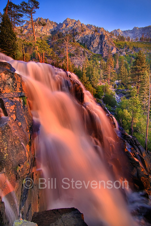 An image of Eagle Falls at sunrise above Lake Tahoe, CA. A slow shutter speed was used to create the silky effect in the water.