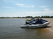 Honda and Seadoo personal watercraft PWC parked on a sand bar in the Arkansas River near Muskogee