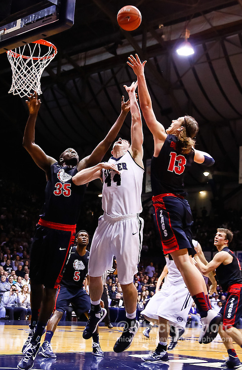 INDIANAPOLIS, IN - JANUARY 19: Sam Dower #35 of the Gonzaga Bulldogs Andrew Smith #44 of the Butler Bulldogs and Kelly Olynyk #13 of the Gonzaga Bulldogs battle for a rebound at Hinkle Fieldhouse on January 19, 2013 in Indianapolis, Indiana. (Photo by Michael Hickey/Getty Images) *** Local Caption *** Sam Dower; Andrew Smith; Kelly Olynyk