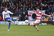 Bury Defender, Joe Riley shoots during the Sky Bet League 1 match between Bury and Doncaster Rovers at the JD Stadium, Bury, England on 9 April 2016. Photo by Mark Pollitt.