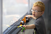 Ryan Heckman, 4, plays in the first row of the stands during an exhibition game at RIT's Gene Polisseni Center on Monday, September 29, 2014.