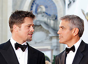 Actors Brad Pitt and George Clooney arrive for the premiere of the movie 'Burn After Reading' which opens the 65th edition of the Venice Film Festival in Venice, Italy, Wednesday, Aug. 27, 2008.  (AP Photo/Joel Ryan)