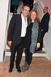 MARK HIX and LARA CAZALET at a dinner in aid The Journalism Foundation held at Philips De Pury & Company, Howick Place, London, SW1 on 22nd May 2012.
