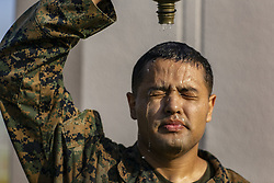 May 23, 2019 - Iwakuni, Japan - U.S. Marine Corps Lance Cpl. Cesar Ramirez pours a canteen of water on his head to cool off after a conditioning hike on a hot day at Marine Corps Air Station May 23, 2019 in Iwakuni, Japan. (Credit Image: © Seth Rosenberg via ZUMA Wire)