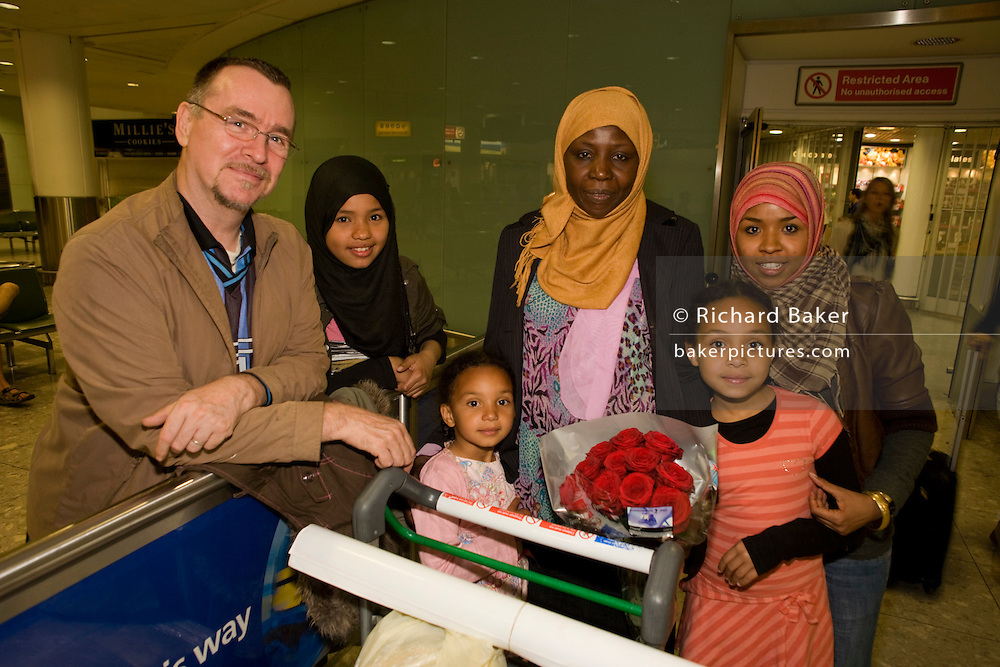 Amna Akeelo, a British citizen but originally from Ed da'ein in Sudanese south Darfur, is greeted at Heathrow airport, London by her husband Noor four of her seven children: Wurwood,12; Mafuzah,5; Fatima, 9 and Zara 23 after a two-week break holiday back hom in the sudan capital, Khartoum. A frequent visitor to her homeland, Anna has opened up a shop in Loughborough, England often importing clothes and local produce.