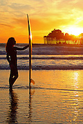 Female Surfer on the Beach at the Pier in Carlsbad
