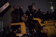 Perched on a dumpster truck, people listen to Former Prime Minister Yulia Tymoshenko who addresses anti-government protesters on Maidan Square during a funeral ceremony to the fallen activists, killed two days earlier in a shootout with the police. February 22, 2014 in Kiev, Ukraine.