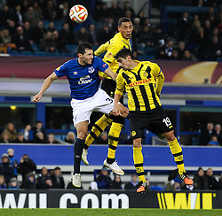 Everton's Antolin Alcaraz challenges Guillaume Hoarau of BSC Young Boys - Photo mandatory by-line: Matt McNulty/JMP - Mobile: 07966 386802 - 26/02/2015 - SPORT - Football - Liverpool - Goodison Park - Everton v Young Boys - UEFA EUROPA LEAGUE ROUND OF 32 SECOND LEG