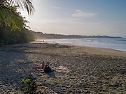 The sun sets at the beach at Manzanillo, Limon, Costa Rica.