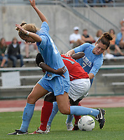 University of North Carolina forward Kealia Ohai (7) and midfielder Kelly McFarlane (11) challenge Ohio State forward Tiffany Cameron (11) as OSU takes on UNC in the first half of an NCAA women's college soccer game in Columbus, Ohio on Sunday, Sept. 4, 2011, at Jesse Owens Memorial Stadium.