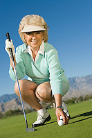 Woman Picking up Golf Ball