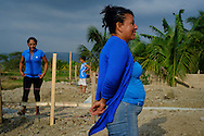 2016/08/03 – Rocaforte, Ecuador: A family walks around their land where the foundation of their new home is ready, Rocaforte, Ecuador, 3rd August 2016. The house is being build by Ministry of Urban Development and Housing (MIDUVI), which started a new rebuilding programme after the 16th April earthquake. The standard house have two small bedrooms and they are valuated in US$10,000, which the occupants have to pay 10%  of it (US$1,000). (Eduardo Leal)